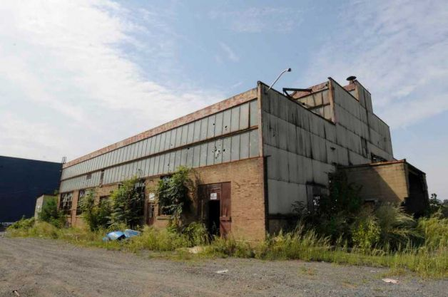 Image of abandoned factory showing need for site repair