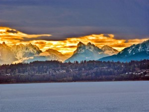 Image of view over Puget Sound to Cascade Mountains at sunrise