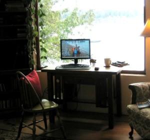 Iimage of computer on desk in window bohemian writing life