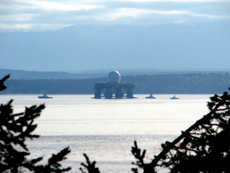 A massive radar dome is towed through Puget Sound
