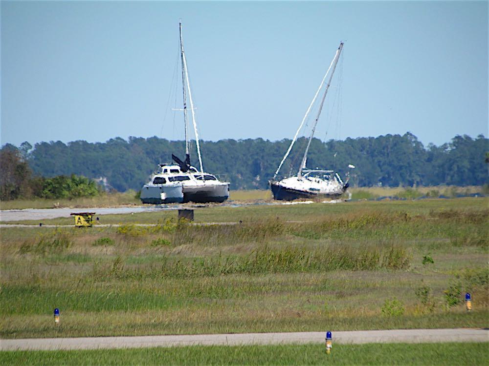 hurricane matthew leaves sailboats on airport runway