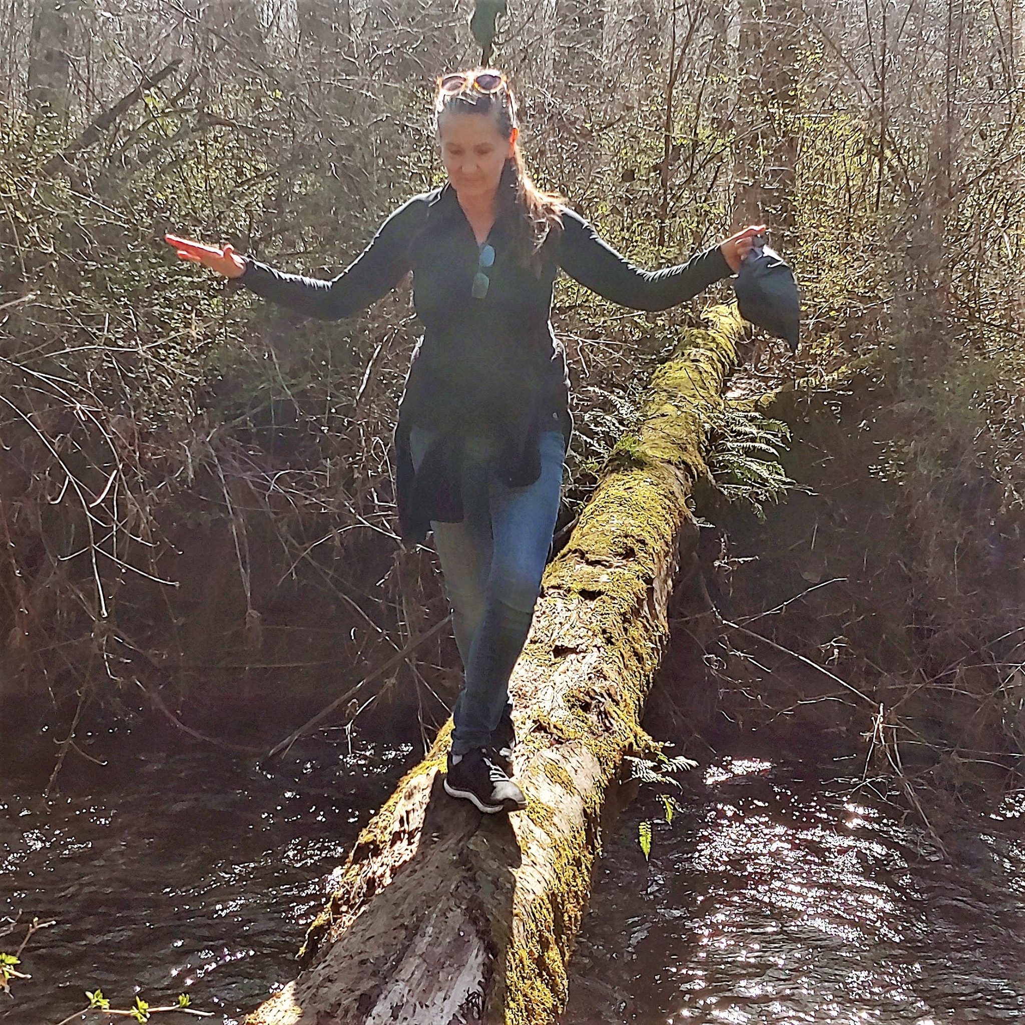 balancing on a log over a creek Introvert skills for interesting times