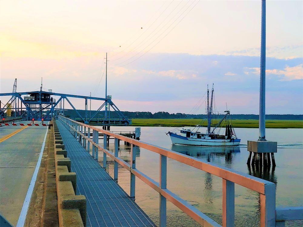 shrimp boat leaving shallow water Harbor River Bridge
