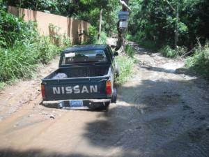 Nissan pickup stuck in muddy road