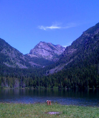 cowboy boots beside a mountain lake
