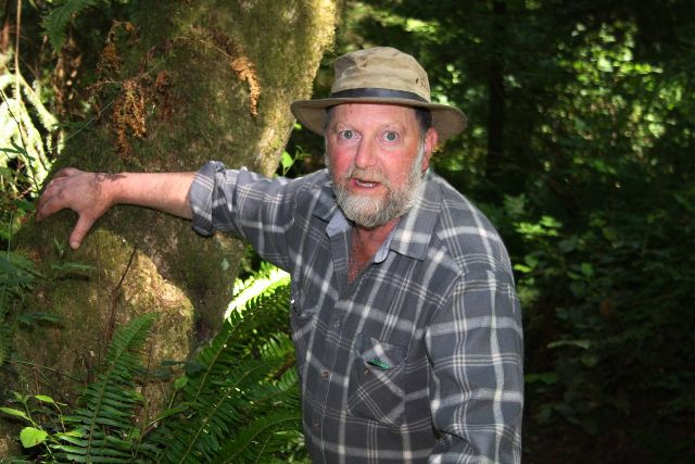 Forester Elliott Menashe in the woods on Whidbey Island