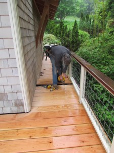 Tom installs the last few deck boards.