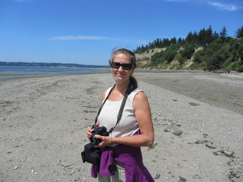 Nancy Bartlett walking the beach at Useless Bay, Whidbey Island, by Candace Allen