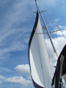 sailboat jib, sailing under blue sky