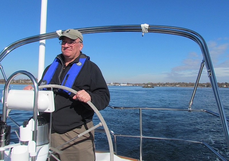 Captain Mark steering the Freedom 38 Rhapsody