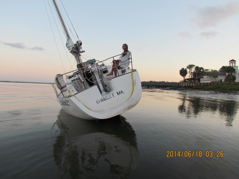 sailboat aground and listing, anchoring too close to shore