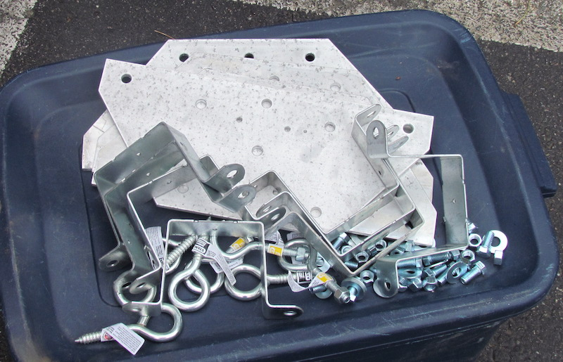 Image of hardware and parts for assembling careening poles