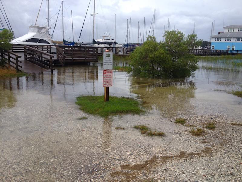 high tide at a marina with flood water