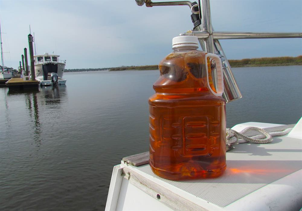 a jug of sun tea on sail boat