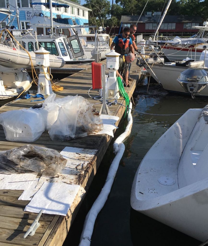 oil spill cleanup crew starts work on oil spill at Lady's Island Marina