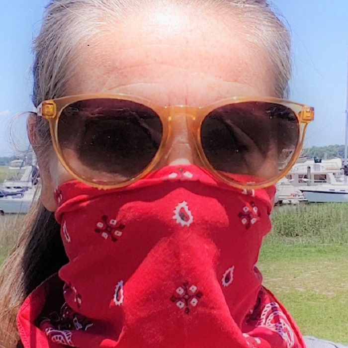 woman wearing bandana mask