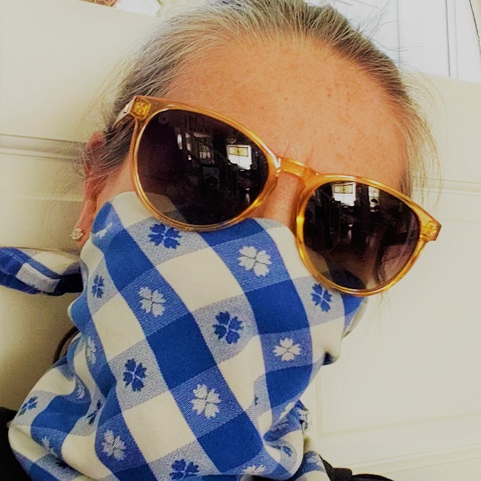 woman wearing blue checked mask